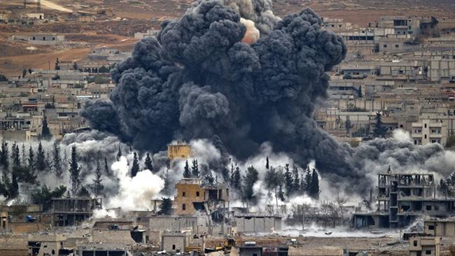 In this file photo, smoke rises from the Syrian city of Kobani following an airstrike by the US-led coalition in November 2015. ©AP